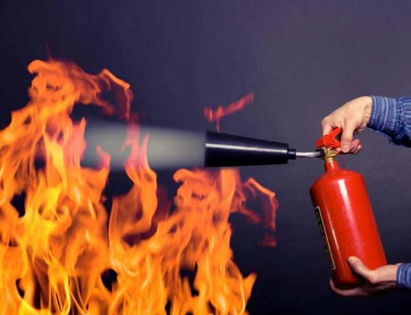 How to use the fire extinguisher to put out a fire