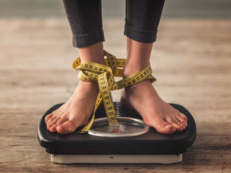 What are the causes of weight gain during menopause